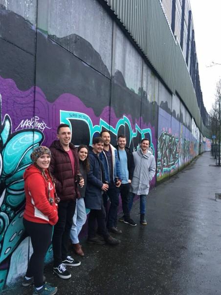"Swannies taking in a ""Peace Wall"" in Belfast."